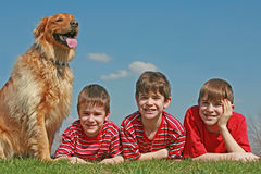 Boys Laying With the Dog stock image