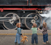 Boys and locomotive Stock Image