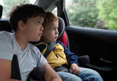 Boys looking out the car window Royalty Free Stock Image