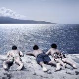 Boys looking at the sea Stock Photos