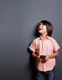 Boys looking upwards while holding a mobilephone Royalty Free Stock Photo