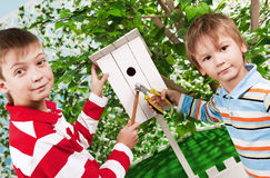 Boys make a birdhouse for the birds Stock Photos