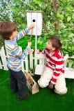 Boys make a birdhouse for the birds Royalty Free Stock Photography