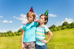 Boys making noise on birthday party Stock Images