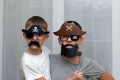 Boys in masks pirate play royalty free stock images