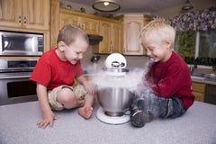 Boys mixing flour stock photography