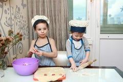 Boys mold dumplings Royalty Free Stock Image