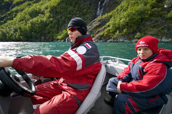 Boys in motorboat Stock Images