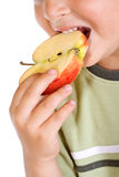 Boys mouth with apple slice Royalty Free Stock Image