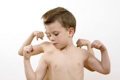 Boys / muscles / series. Boys showing muscles. Focus on the face Royalty Free Stock Image