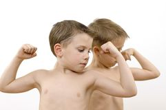 Boys / muscles / series. Boys showing muscles. Focus on the face Royalty Free Stock Photography