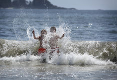 Boys in the ocean Stock Photos
