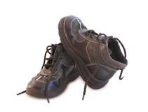 Boys old boots with lace undone Stock Photos