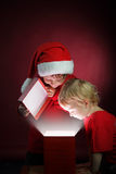Boys open christmas gift-box Stock Photography