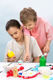 Boys painting. Children working together on a project during art and craft class stock photo
