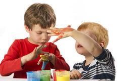 Boys painting with finger paint Stock Photo