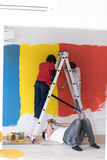 Boys painting wall Royalty Free Stock Image