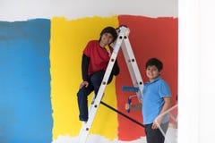 Boys painting wall Royalty Free Stock Photo