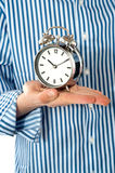 Boys palm holding alarm clock Stock Image