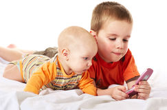Boys and phone. Two brothers play whith phone royalty free stock photos