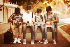 Boys with phones and tablets royalty free stock photo