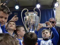 Boys are photographed with a trophy of the UEFA Cup. Kyiv / Ukraine - 21 April, 2018: Boys are photographed with a trophy of the UEFA Cup stock images