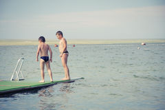 Boys on pier Stock Photo