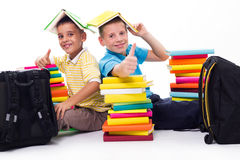 Boys with piles of books Stock Image