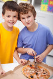Boys with pizza Royalty Free Stock Photo