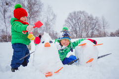 Boys plaing in the snow Stock Image
