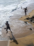 Boys play on the beach adjacent to Galle Face Green in Colombo in Sri Lanka. Royalty Free Stock Images