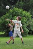 Boys play with boll. Two boys play with boll on summer day Stock Photography