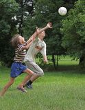 Boys play with boll. Two boys play with boll on the green grass Royalty Free Stock Photo