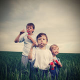 Boys play in  bubbles Stock Photos