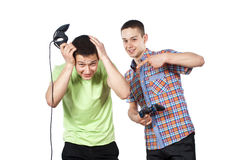 Boys play computer games on the joystick. S isolated Royalty Free Stock Photo