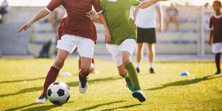 Boys Play Football. Running Football Soccer Players. Kids at Soccer Field Running with Ball stock image