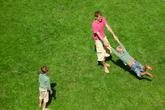 Boys play with the man outdoor. The Top view. Stock Photos