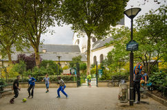 Boys play soccer in a Paris park Stock Images