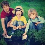 Boys play in  stream Stock Photos