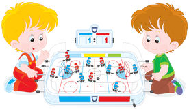 Boys play table hockey Stock Photo
