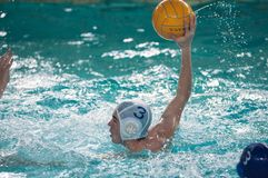 The boys play in water polo. Orenburg, Russia - 6 May 2015: The boys play in water polo on City tournament Royalty Free Stock Image