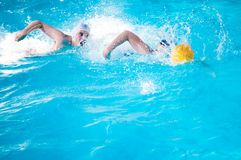 The boys play in water polo. Royalty Free Stock Photography