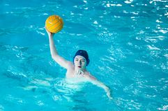 The boys play in water polo. Orenburg, Russia - 7 May 2015: The boys play in water polo on City tournament Stock Photo
