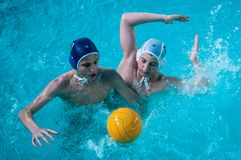 The boys play in water polo. Orenburg, Russia - 7 May 2015: The boys play in water polo on City tournament Stock Image