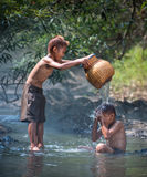 Boys play in water Royalty Free Stock Photo