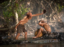 Boys play in water Royalty Free Stock Images