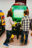 Boys playing arcade game. In games arena Royalty Free Stock Images