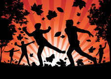 Boys playing in the Autumn Leaves Royalty Free Stock Images