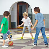 Boys playing with ball on Royalty Free Stock Photography