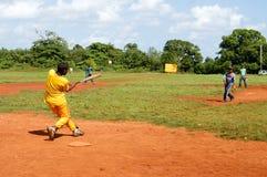 Boys playing baseball on a field at Las Galeras Stock Images